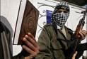 Ilustrace k článku: Medzi povstalcami sú aj teroristi (SME)